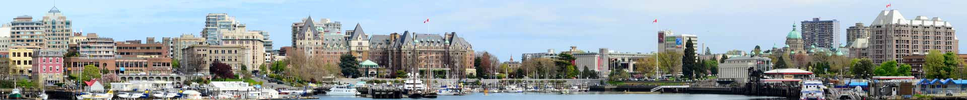 Downtown Victoria harbour skyline showing the Empress Hotel, Royal BC Museum, Legislative Assembly of British Columbia and much more.